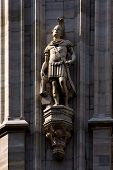 stock photo of castello brown  - a roman soldier in the front of the dome of milan - JPG
