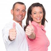 Happy couple in front of white background with thumbs up