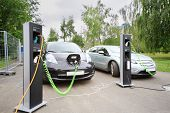 MOSCOW - AUGUST 18: Two electric cars recharged at electrical charging at festival Ekofest 2012 on b