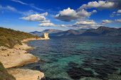 stock photo of martello  - The original Mortello Tower at Punta Mortella on the coast of the Desert Des Agriates near St Florent Corsica - JPG
