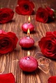 foto of unity candle  - Romantic composition with red candles and roses. selective focus