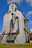 stock photo of auger  - A historic old metal elevator with augers - JPG