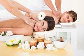 foto of acupressure  - Portrait of smiling young couple receiving massage at spa - JPG