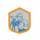 stock photo of theodolite  - Metallic styled illustration of a surveyor geodetic engineer with theodolite instrument surveying viewed from side set inside shield crest done in retro style on isolated white background - JPG