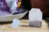 image of tea bag  - Paper bag with tea and the big cup for tea on a background - JPG