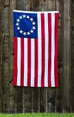 foto of betsy ross  - 13 Star American flag the Betsy Ross flag displayed on rustic wooden fence - JPG