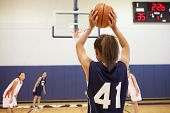 stock photo of 13 year old  - Female High School Basketball Player Shooting Basket - JPG