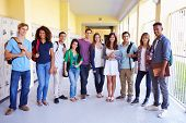 stock photo of 16 year old  - Group Of High School Students Standing In Corridor - JPG