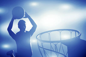 pic of slam  - Basketball player silhouette jumping and making slam dunk - JPG