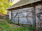 stock photo of gate  - Rustic wooden barn gate of old aged barn - JPG