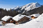 picture of chalet  - chalets in the mountains covered with snow - JPG