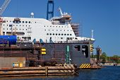 stock photo of shipbuilding  - Ship is being renovated in shipyard Gdansk Poland - JPG