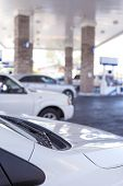 picture of gasoline station  - Line of Cars Refilling at Gasoline Station in the Afternoon - JPG