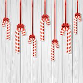 picture of candy cane border  - Set of Christmas candy canes with bow on wooden background - JPG