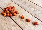 pic of filbert  - Stack of nuts filbert on wooden background - JPG