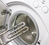 pic of scum  - Washing machine and old damaged electric heater - JPG
