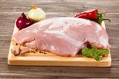 picture of turkey-hen  - Raw turkey fillet on cutting board on white background - JPG