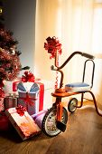 pic of tricycle  - Vintage christmas with decorated tree gifts and retro tricycle - JPG