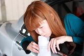 image of vomiting  - concept shot of young Japanese woman vomiting with carsickness - JPG