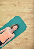 stock photo of yoga mat  - Top view of woman relaxing on yoga mat with copy space - JPG