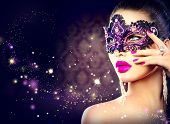 stock photo of lipstick  - Sexy model woman wearing venetian masquerade carnival mask at party over holiday dark background - JPG