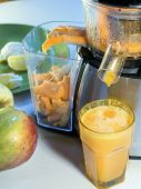 picture of fruit-juice  - extractor juice low rpm in working produces fresh juice without oxidation fruit around - JPG