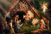 stock photo of christmas baby  - Colorful Nativity Scene with baby Jesus Mary Joseph an angel and other famous religious figures of the bible enhanced with rays of light for devotional mood - JPG