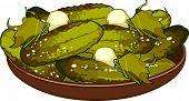 stock photo of fruit platter  - green pickles with garlic on a platter - JPG