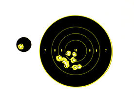 stock photo of shooting-range  - target with bullet holes in it showing good grouping and adjustment made to the sights to improve performance - JPG