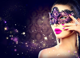 stock photo of face mask  - Sexy model woman wearing venetian masquerade carnival mask at party over holiday dark background - JPG