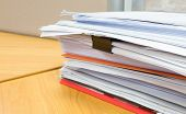 image of mayhem  - pile of documents on the office desk - JPG