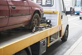 image of tow-truck  - Roadside assistance car towing truck in the city - JPG