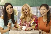picture of ice-cake  - Pretty young female friends having cake and ice cream at outdoor cafe - JPG