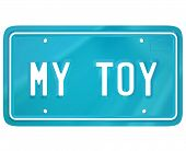 Постер, плакат: My Toy words on a vehcile license plate to illustrate a car collector or restoration hobby or pastti