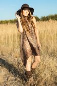 picture of wander  - Beautiful young model wandering through meadow at midday - JPG