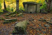 pic of megaliths  - Ancient portal dolmen standing in scenic forest - JPG