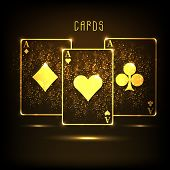picture of ace spades  - Golden ace cards on shiny brown background for casino concept - JPG