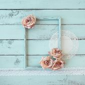 foto of shabby chic  - Wooden photo frame with lace and flowers on mint shabby chic background - JPG