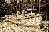 foto of old boat  - Old weathered fishing boat tied up and waiting - JPG