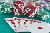 stock photo of flush  - Royal Flush On The Green Casino Table Background - JPG