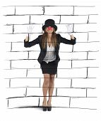 picture of mockingbird  - Businesswoman plays to mime imagining a wall - JPG