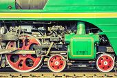 stock photo of locomotive  - Mechanical part and wheels of the retro steam locomotive - JPG