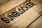 pic of heatwave  - wooden letters on old aged wooden table build the shadow word sunblocker vintage style - JPG
