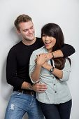 pic of multicultural  - A portrait of a happy young multicultural couple - JPG