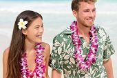 pic of traditional attire  - Happy Hawaii beach couple in Aloha Hawaiian shirt - JPG
