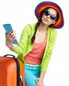 stock photo of boarding pass  - Portrait of female tourist with travel suitcase and blue boarding pass - JPG