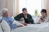 stock photo of terminator  - Children does not care about their terminally ill dad - JPG