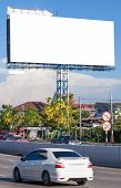 stock photo of beside  - View of blank billboard beside street for public advertisement during people transportation - JPG