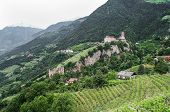 image of fountains  - View from Tirol village near Merano Italy toTyrol Castle the fountain - JPG