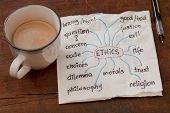 stock photo of coffee-cup  - cloud of words related to ethics on a napkin with a cup of coffee on weathered wooden table - JPG